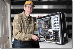 stock-photo-wild-eyed-computer-geek-working-on-the-inside-of-a-pc-computer-with-a-screw-driver-26600344